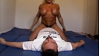 Nude female bodybuilder dominates male with scissors, facesits, pest smothers and breast