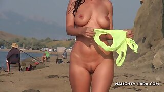Poor Russian bitch in Swimsuit on beach - big tits fulgid outdoors